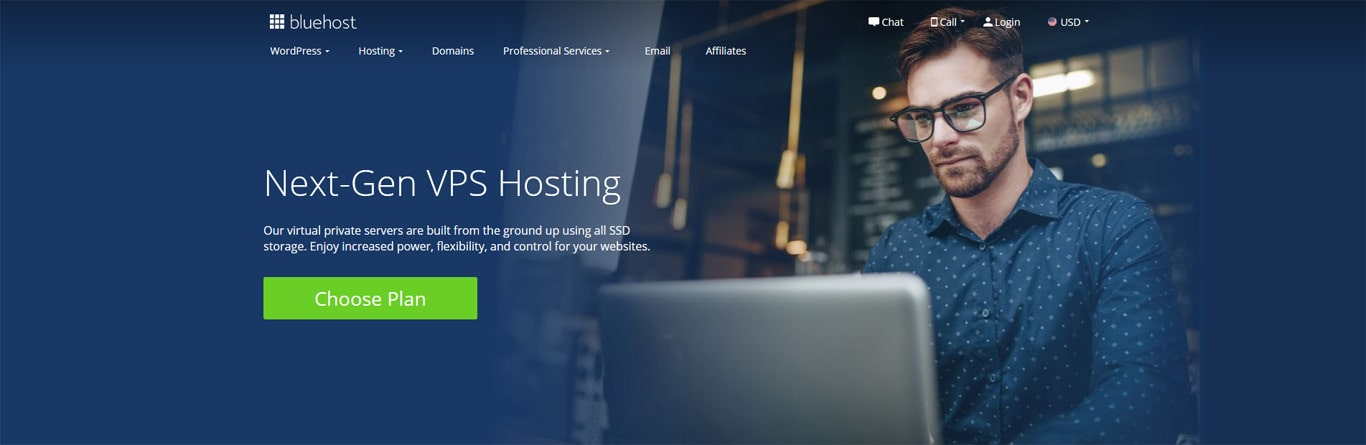 Bluehost's virtual private server page with a man holding a laptop