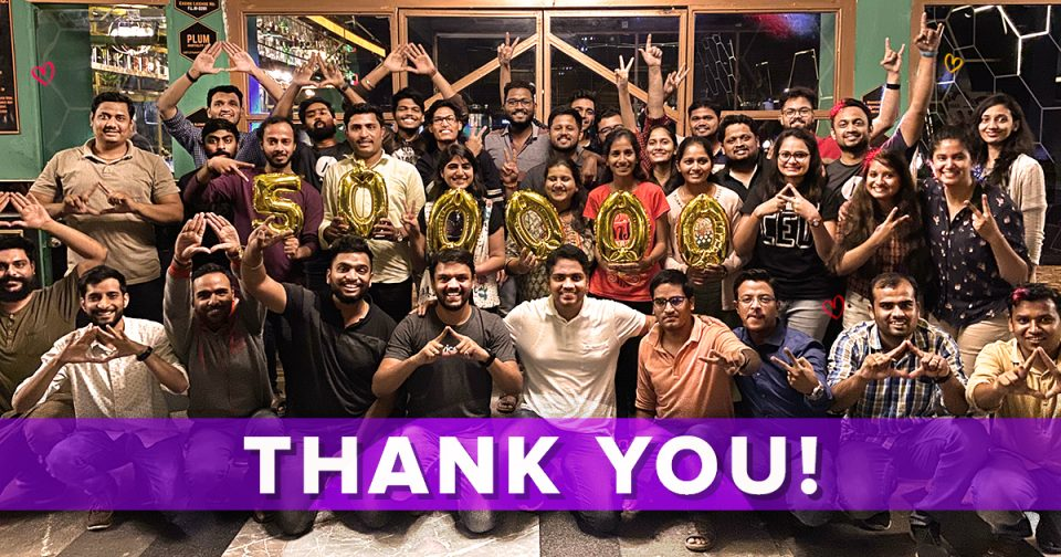 Astra team celebrating 500k active installs